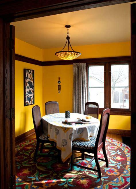 dining room bright yellow walls  beige ceiling dark