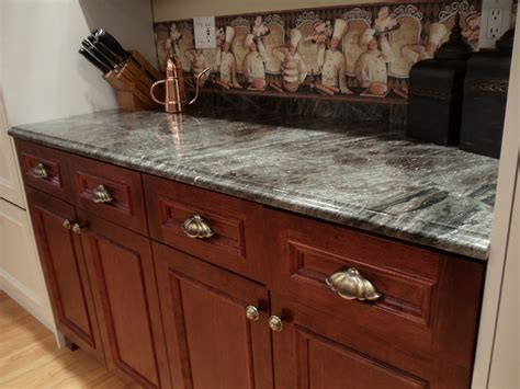 cherry cabinets with gray countertops exles of our work scrivanich natural stone