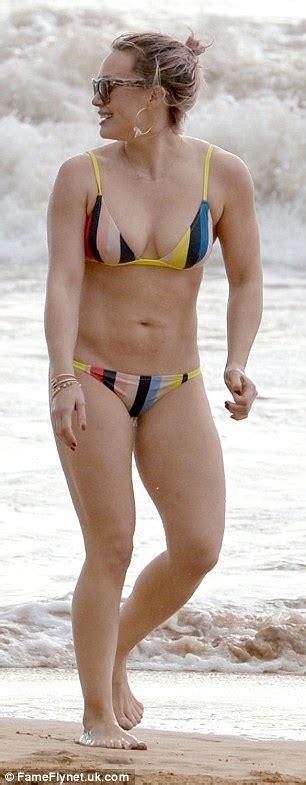 mike white swimsuit hilary duff slips into a striped bikini as she on family