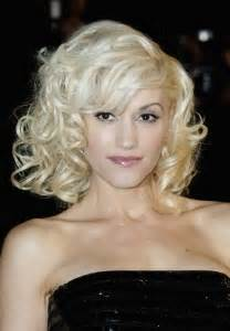 Blonde Curly Medium Hairstyle with Bangs