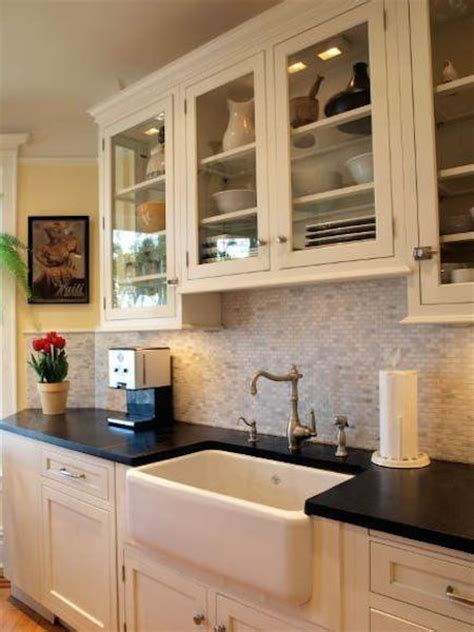 over the kitchen sink wall decor options for a kitchen design with no window over the sink