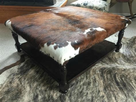 cowhide ottoman coffee table with lower shelf