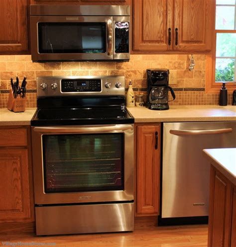 best hardware for oak cabinets great kitchen showing how stainless appliances do go with