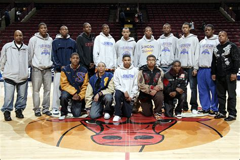 bulls honor whitney young high school boys basketball team