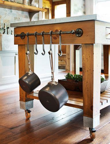kitchen island with pot rack pot rack on the side of the island kitchen