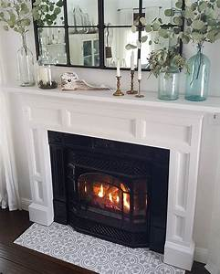 a diy stenciled fireplace hearth floor using the augusta With stylish options for fireplace tile ideas