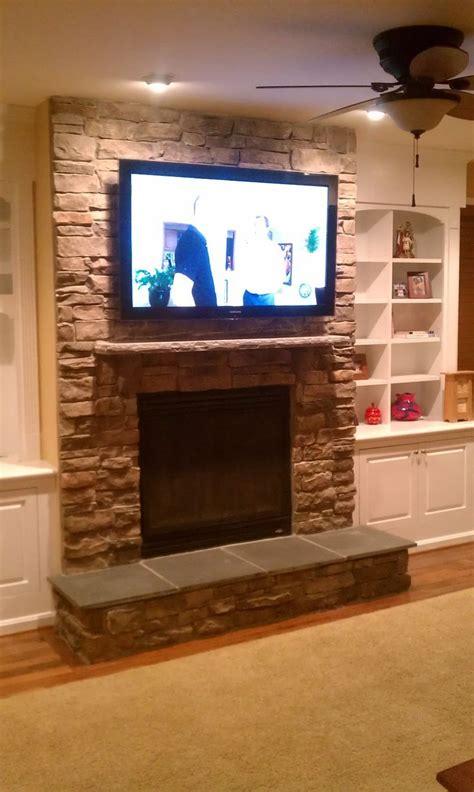 stone fireplace  tv  fireplace tv installation