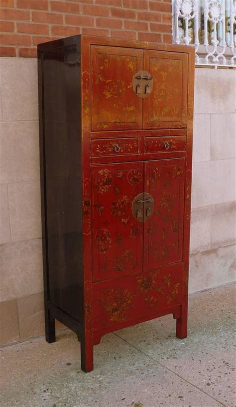 fine red lacquer armoire with gilt motif for sale at 1stdibs