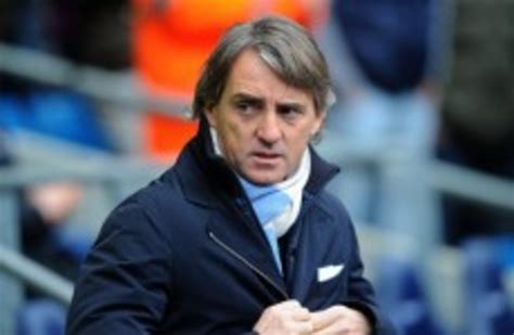 That goes to the identity of the man himself; Which Manchester City player would Roberto Mancini like to punch?