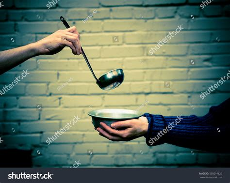 homeless hands one man metal plate stock photo 539214820