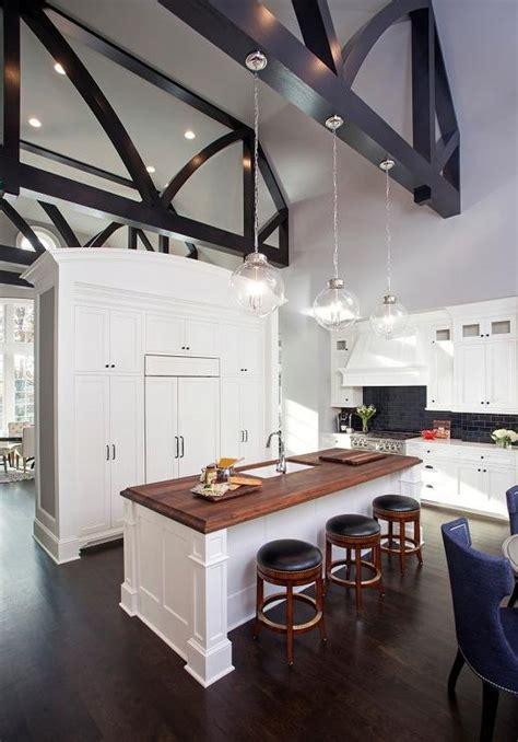 lighting hanging  truss ceiling transitional kitchen