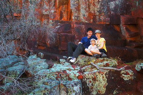 photographer couple carry  kids   backs
