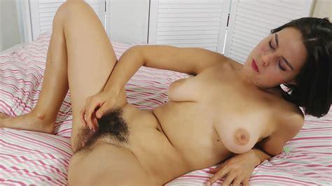 Brunette Hairy Babe Masturbates While She Has A Bush By