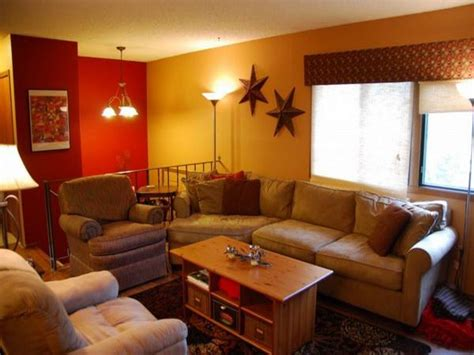 ideas elegant tan living couch feat red  yellow wall