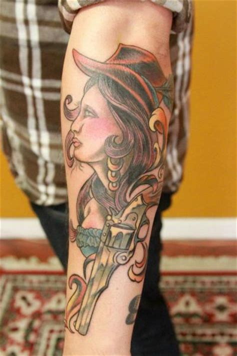 arm  school women gun tattoo  revolver tattoo