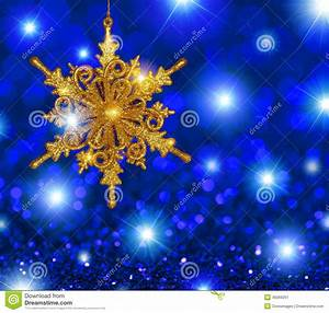 Gold Snowflake Star On Blue Stars Background Stock Photo ...