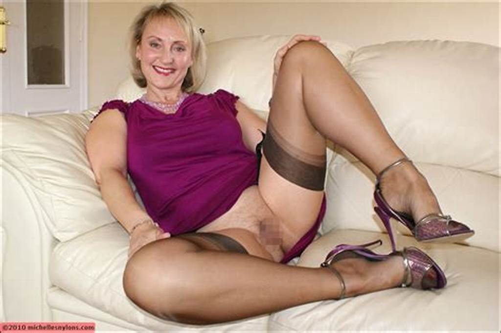 #Very #Foxy #Blonde #Mature #Lady #Spreads #Her #Legs #On #The #Sofa