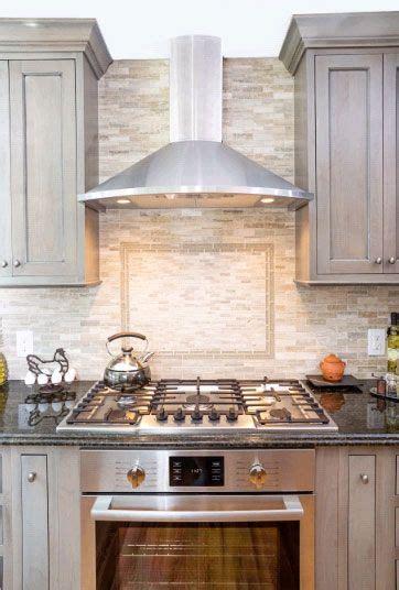 mosaic backsplash  framed tile design  cooktop