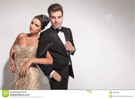 elegant couple posing  holding arms stock image