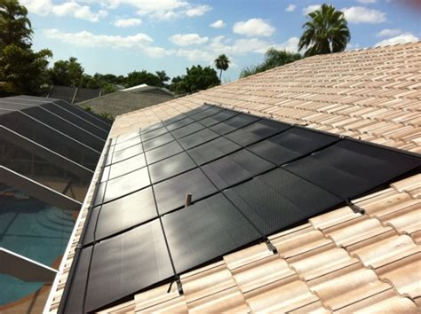 solar pool heating panels on barrel tile tile roof