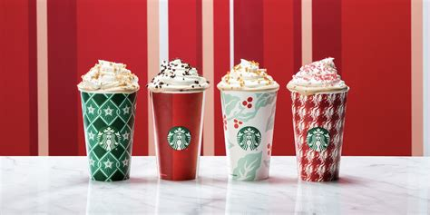 starbucks releases  holiday cups starbucks christmas red cups announced