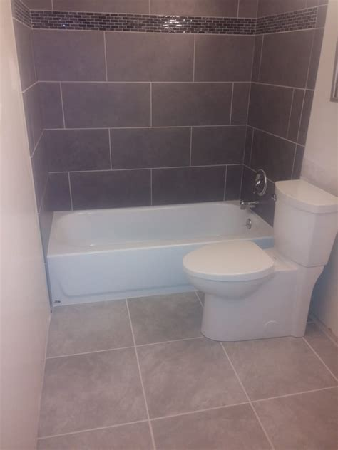 12x24 grey porcelain on subway lay with 4inch glass liner