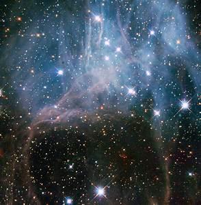 NASA - Hubble Peeks inside a Stellar Cloud