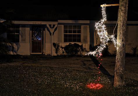 funny christmas treelights with deer palm gardens homeowner hangs dead reindeer display tribunedigital sunsentinel