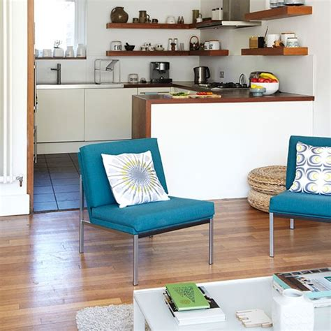 modern white kitchen  teal chairs kitchen decorating