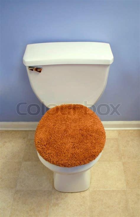 modern  toilet   fuzzy orange toilet seat