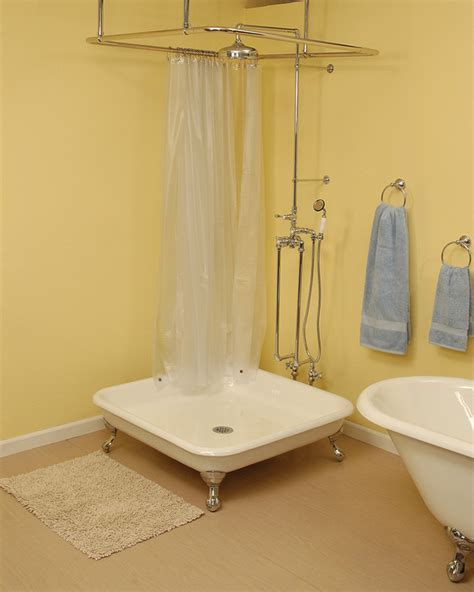 CAST IRON SHOWER PAN WITH OIL RUBBED BRONZE LEGS   Strom
