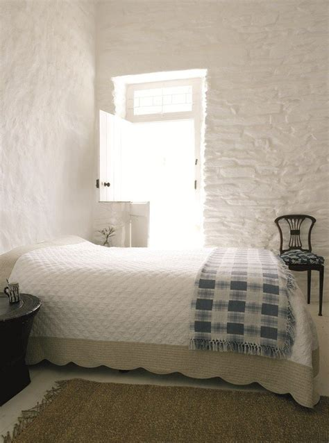 roses  rust lime washed stone walls stone walls