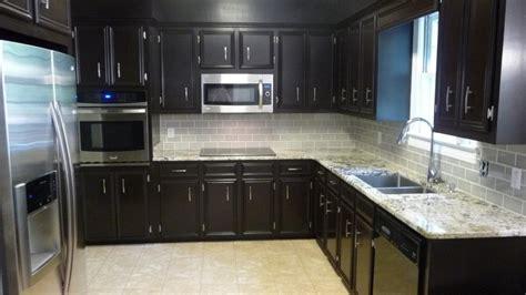 dark cabinets light countertops backsplash dark cherry cabinet with white backsplash ideas for