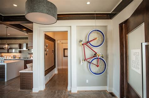 hanging bike rack on ceiling with indoor entry room also drum pendant light and exposed wooden