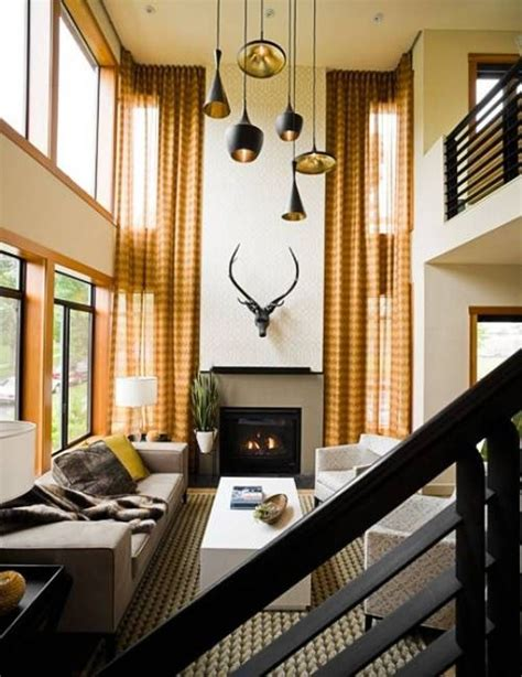 living room with contemporary pendant high ceiling