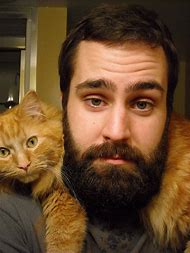 Man with Beard and Cat