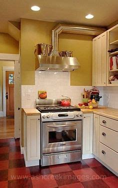 industrial chic stove with heater shelf, exposed duct work