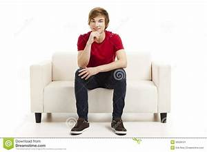 Young Man Sitting On The Couch Stock Image - Image: 36228121