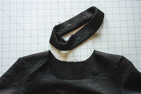 Neck binding fabric {rib knit, knit shirt fabric, old neckband} begin by sewing one of the shoulder seams with right sides together. How to Sew a 3D Neck Binding for Knit Fabrics | Closet ...