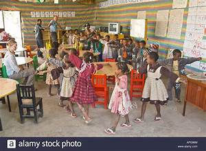 Children playing a game in the classroom of a charity run ...