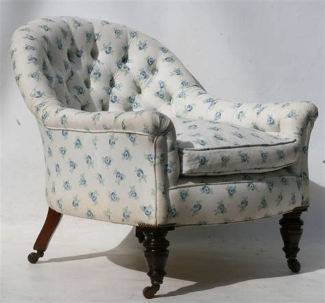 a late tub chair upholstered in buttoned cotton