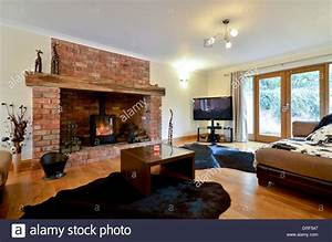 Contemporary Lounge With Wood Burning Stove Stock Photo