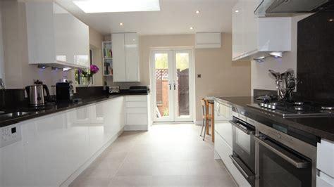 white gloss finish cupboards  dark granite effect