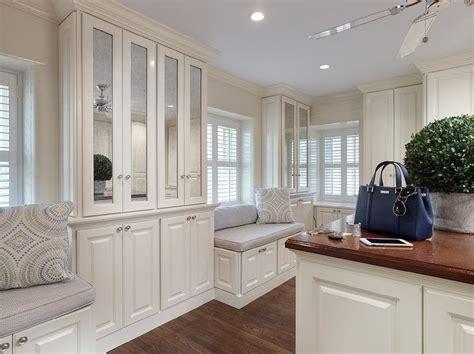 White and Gray Walk In Closet with Mirrored Closet Doors