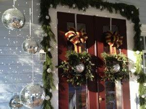 Decorating front porch for Christmas Mirror ball