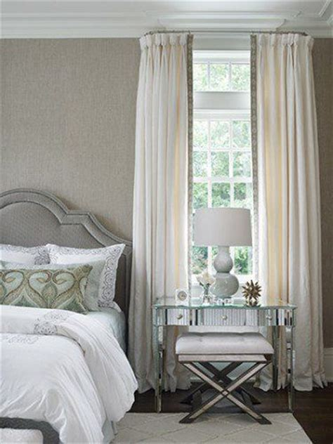 the curved curtain rod is a detail tudor style