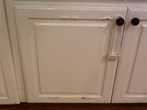 how to fix cabinets hometalk water damage on press wood kitchen cabinets