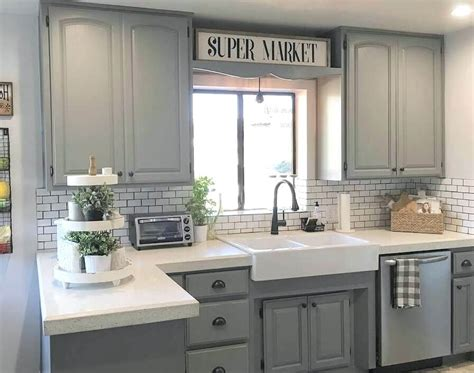 kitchen cabinets with light countertops light grey kitchen cabinets gray with white