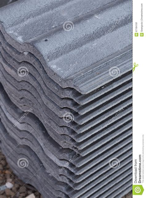 concrete roof tile gray color at construction site stock