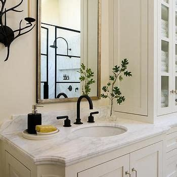 ivory bathroom with rubbed bronze fixtures bath